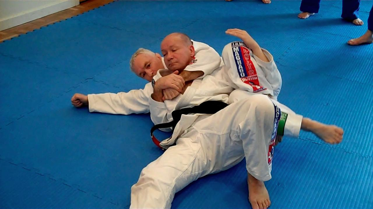 John Will demonstrating the Crucifix on his 2nd Black Belt student, Sean Kirkwood